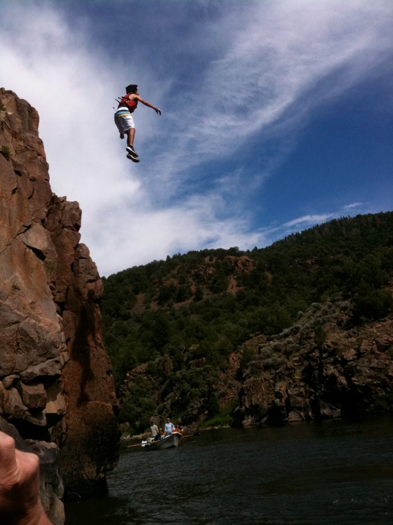 Cliff dive (optional) during White Water Raft trip
